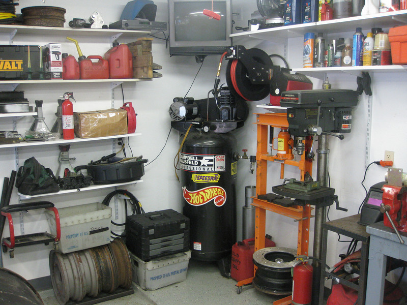 Wheels For My Project Car As Always Above This Stuff Is More Shelving A 50 Retracting Air Hose Reel And TV Which Also Doubles Music Source